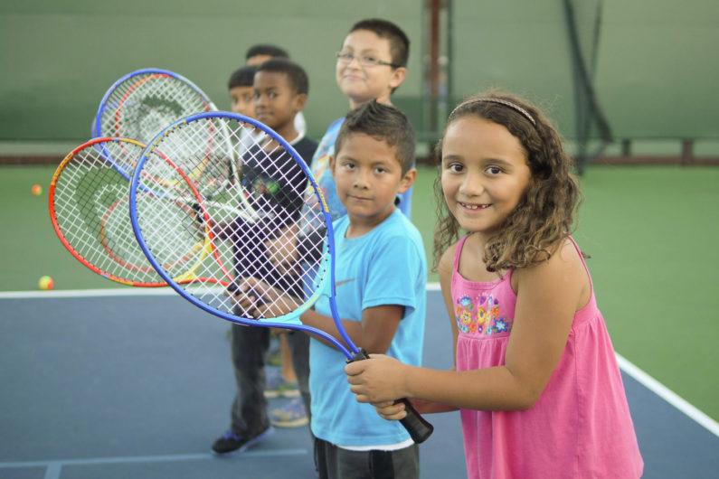 Children learning tennis