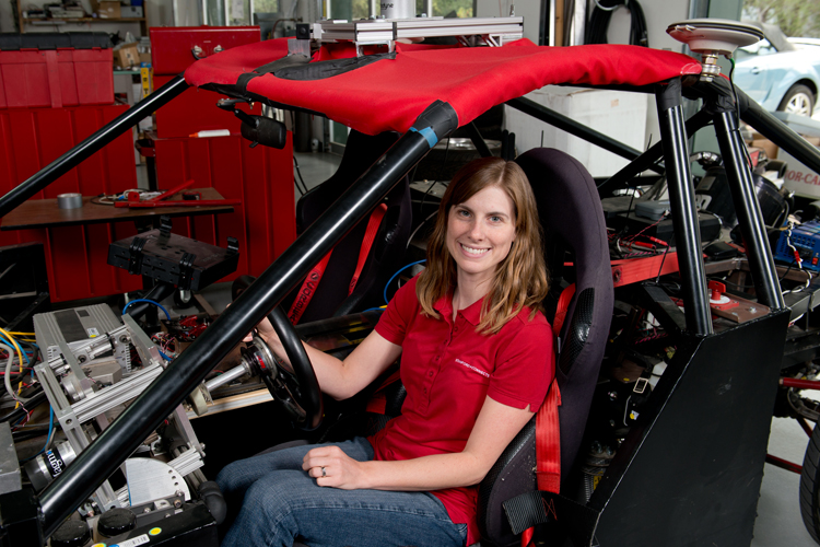 researcher Holly Russell sitting in research vehicle