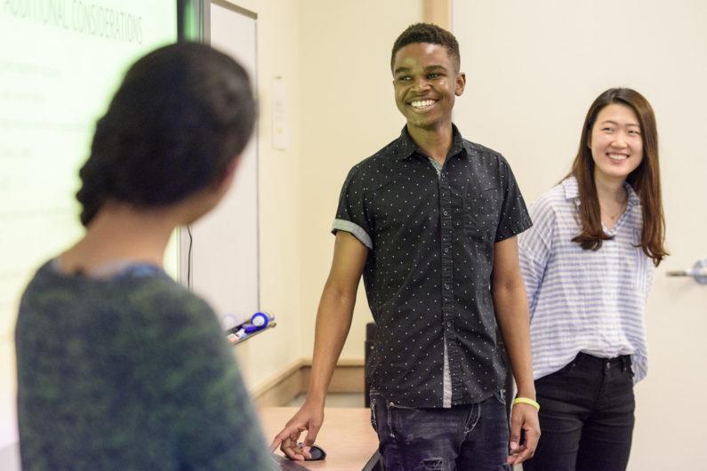 Helen Park, right, and Timothy Tatenda Mazai chat with Mayuka Sarukkai