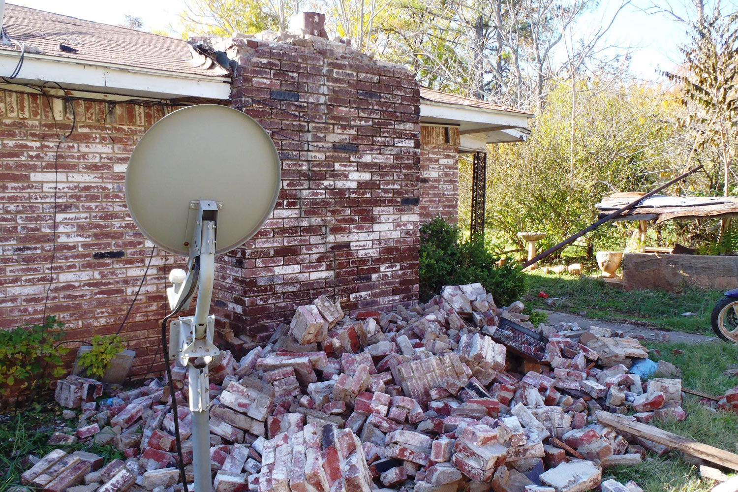 A fallen brick chimney of a house in Oklahoma after a magnitude 5.6 earthquake likely induced by injection into deep disposal wells in the Wilzetta North field; Nov. 6, 2011.