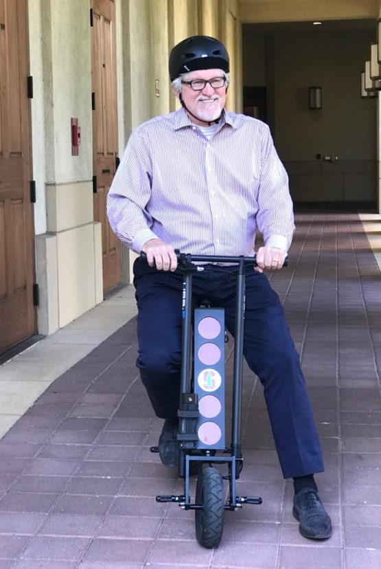 Jeff Raikes on scooter.