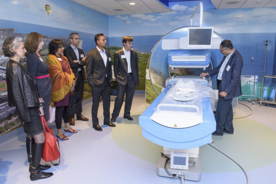 Members of the board at a demonstration of an MRI machine