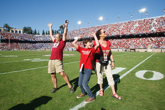Michael Levitt, winner of the 2013 Nobel Prize in Chemistry, was recently honored during a Cardinal football game with his wife and son. (Photo: Stanford Athletics)