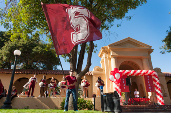 Members of the Stanford Axe committee and the Stanford Band perform during the noon rally.