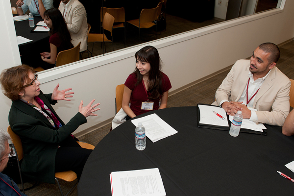 Robin Garrell, vice provost and professor of chemistry  and  biochemistry at UCLA, talks with  Gabriela Bernal, Stanford Graduate student of material science and engineering, and Peter Sorel right, UC Berkeley graduate student in chemical engineering during informational discuss session at the California Alliance Retreat.   (Photo credit:  Steve Castillo)
