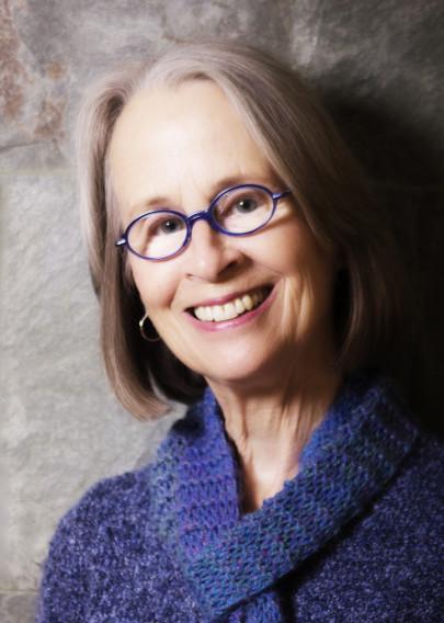 Headshot of Maria Gitin. She's wearing a purple sweater