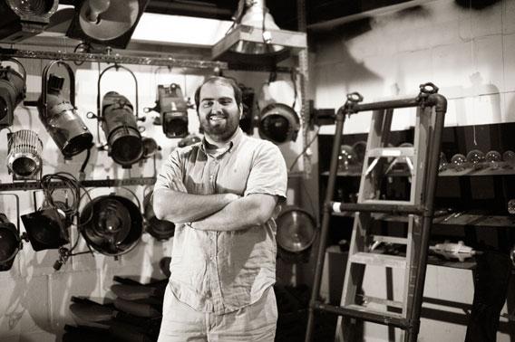 Matt Lathrop portrait in front of theater lighting fixtures