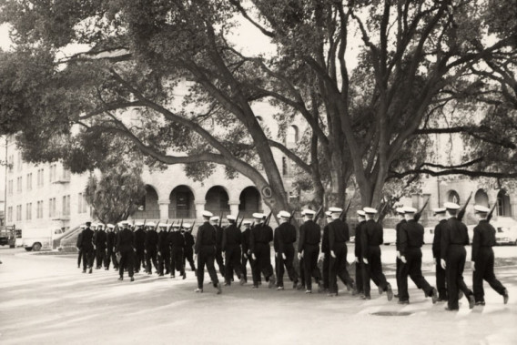 Naval ROTC, early 1960s, conducting a marching drill with rifles outside Encina Hall. (Photo courtesy Stanford University Archives.)