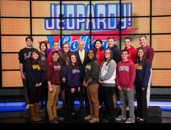 Contestants on the 2016 Jeopardy! College Championship with host ALEX TREBEK.