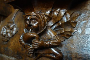 A winged musician plays the bagpipies in this misericord in All Souls College Chapel at Oxford University.
