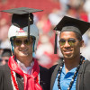 Former football teammates Josh Nunes and Jemari Roberts at Commencement's Wacky Walk / Linda A. Cicero