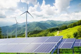 solar panels and wind turbines / genuisksy/Shutterstock