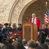 University President John Hennessy at lectern, with faculty on stage, at Stanford's 125th Opening Convocation / L.A. Cicero