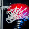 Multi-exposure of a football helmet simulating impact on the top of the helmet. / Photo: L.A. Cicero