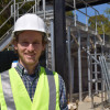 Sebastien Tilmans in front of the William and Cloy Codiga Resource Recovery Center. / Photo: Kate Chesley