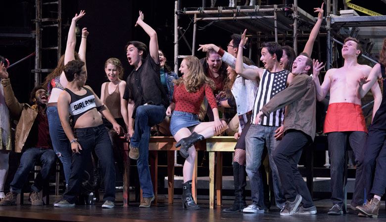 scene with cast members of Rent across the stage