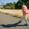man walking on path / L.A. Cicero