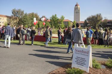 students walking toward activity fair on Meyer Green