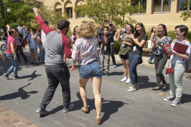 dancers perform at the activities fair for a crowd of admits