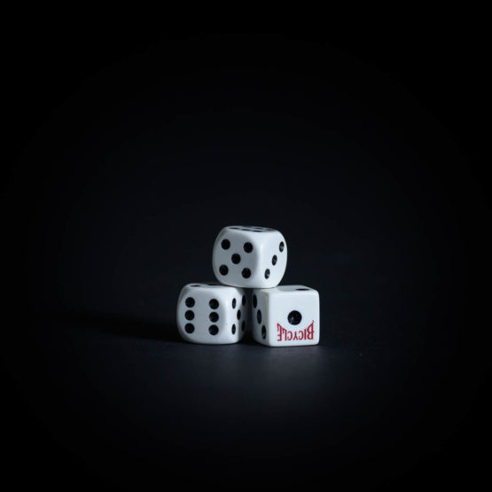 Three die stacked on each other