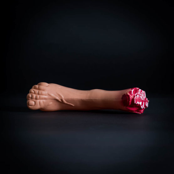 Plastic bloody severed foot