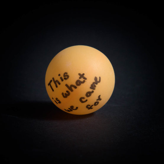 "Ping pong ball with ""This is what we came for"" written on it"