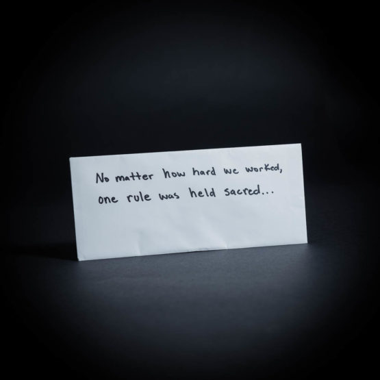 "Envelope with ""No matter how hard we worked, one rule was held sacred..."" written on it in marker"