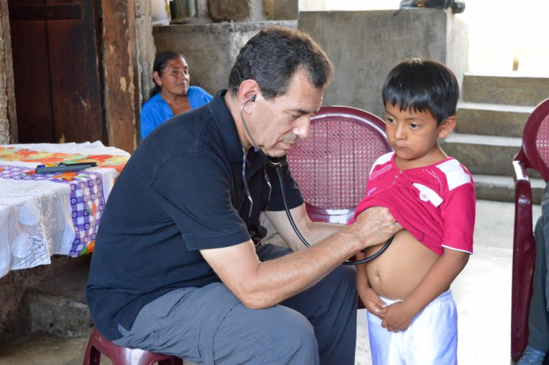 Dr. Paul Wise examining a boy in rural Guatemala