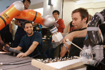 Stanford students and their robots