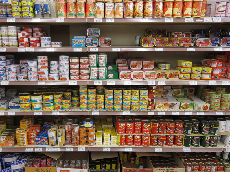 canned food on supermarket shelf
