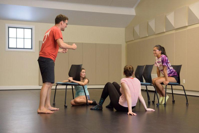 Drama instructor Felix Abidor and 3 students