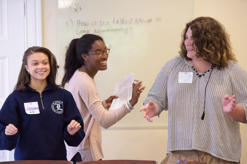 Stanford Anti-Violence Educators Jazzmin Williams, Lola Tijani and Erika Lynn Kneeger lead a practice training session