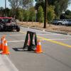 researchers testing autonomous vehicle on a street course
