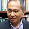 Francis Fukuyama with library books in background