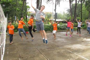 Sean Strong with children in Vietnam's Mekong Delta
