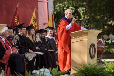 John Hennessy speaking at podium