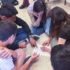 Teens cooperating in activity