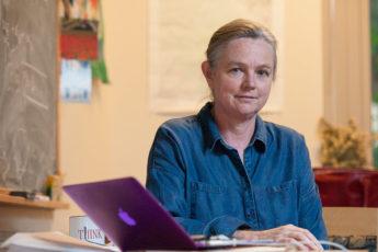portrait of Susan Holmes, professor of statistics, at desk with laptop computer