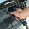 closeup of electric vehicle being charged