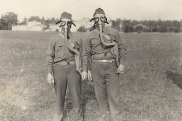 students wearing gas masks