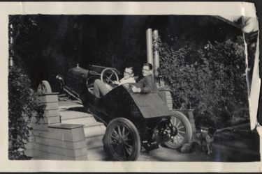 students driving a car up the stairs to a house in 1929