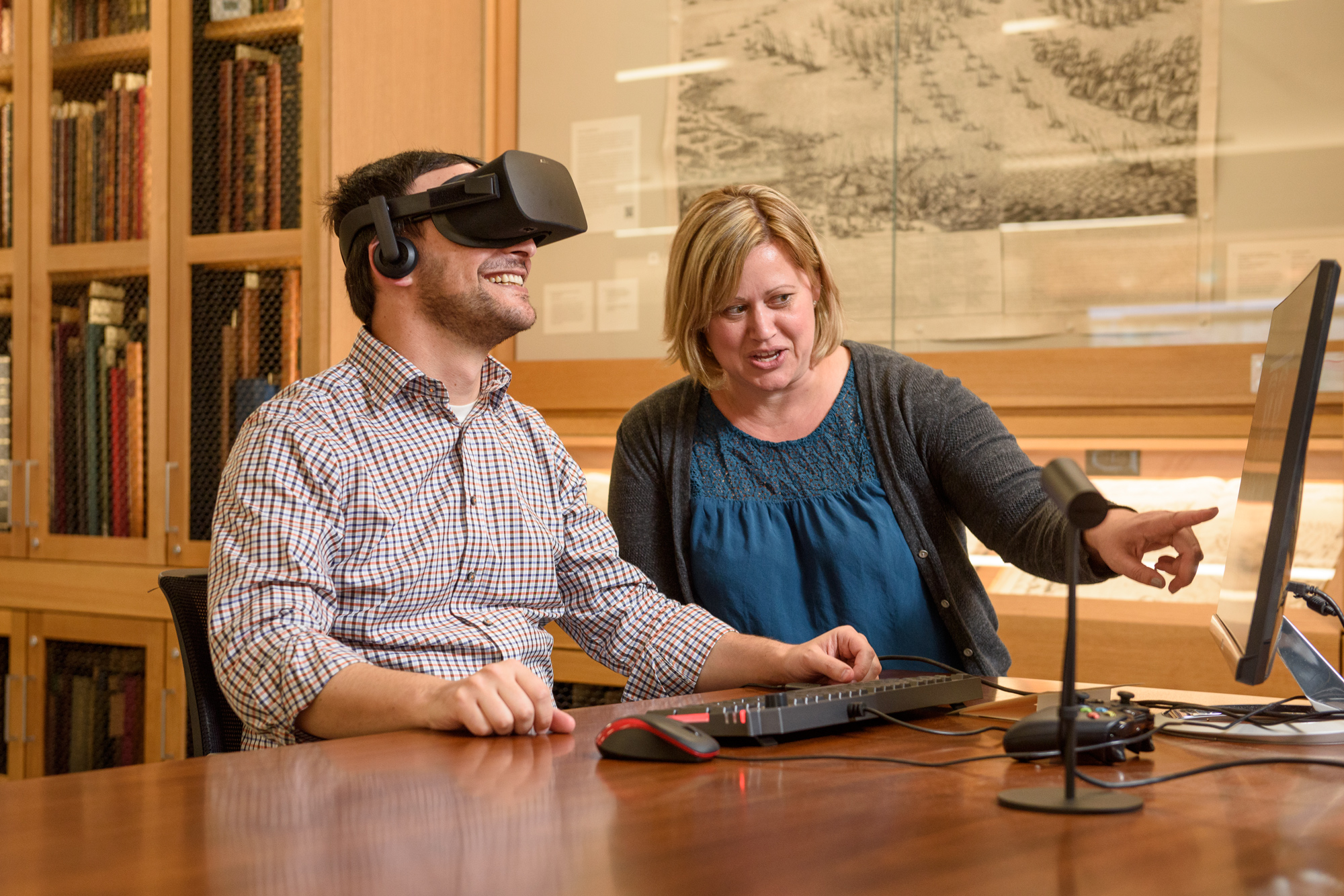 Archivists Josh Schneider and Jenny Johnson viewing virtual reality film