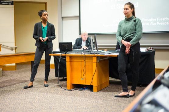 Jackson Beard and Amanda Edelman standing before the senate.