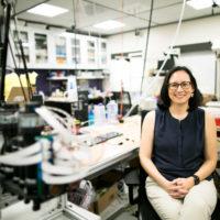 Allison Okamura sitting in her lab