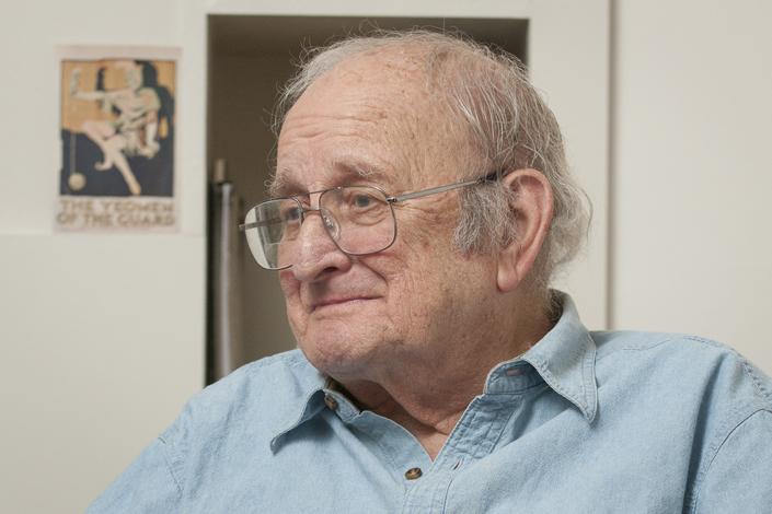 portrait of drama professor Carl Weber in his office