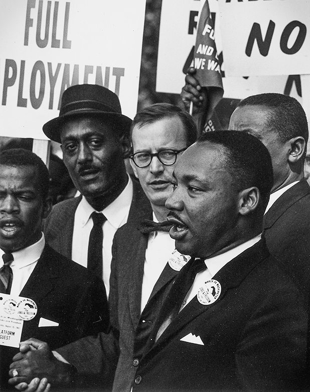 Martin Luther King, Jr., president of the Southern Christian Leadership Conference, and other civil rights leaders during march in Washington, D.C.