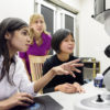 Fariah Hayee, Jen Dionne and Ai Leen Koh working at an electron microscope