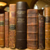 Leather-bound books from late professor of English Jay Fliegelman's collection of 'association copies' acquired by Green Library's Special Collections