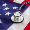 Healthcare reform concept with stethoscope and American flag