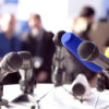 microphones set up on a lectern for a press conference